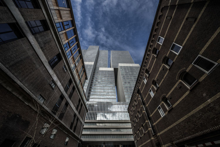 Iconic building DeRotterdam by OMA in Rotterdam, Netherlands. Here seen from low angle with a very wide lens ;) Rotterdam The Architect - 2018 EyeEm Awards Architecture Building Building Exterior Built Structure City Derotterdam Low Angle View Modern Sky