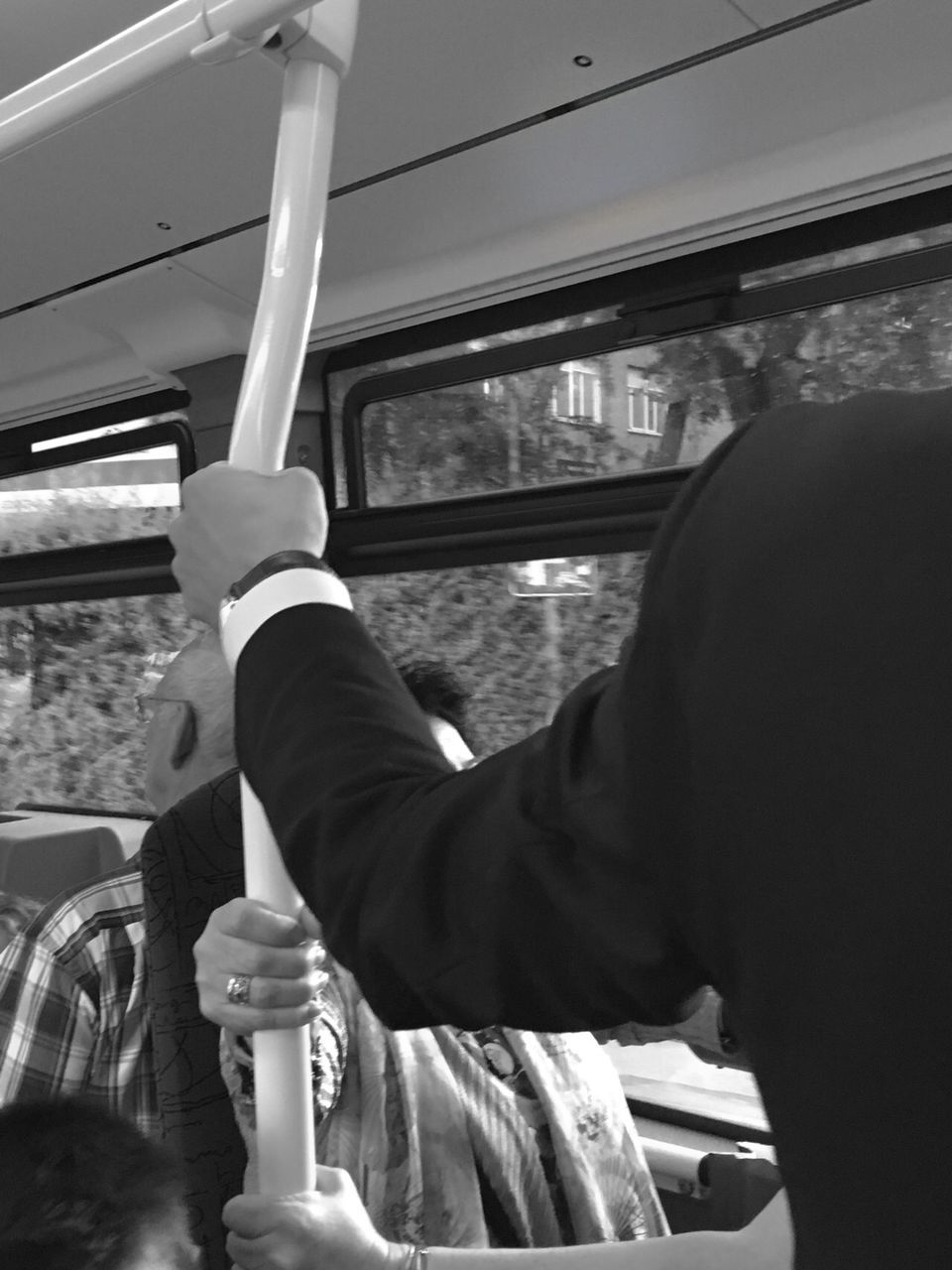 real people, one person, vehicle interior, transportation, mode of transportation, public transportation, rail transportation, men, window, day, train, train - vehicle, land vehicle, lifestyles, travel, hand, holding, sitting, leisure activity