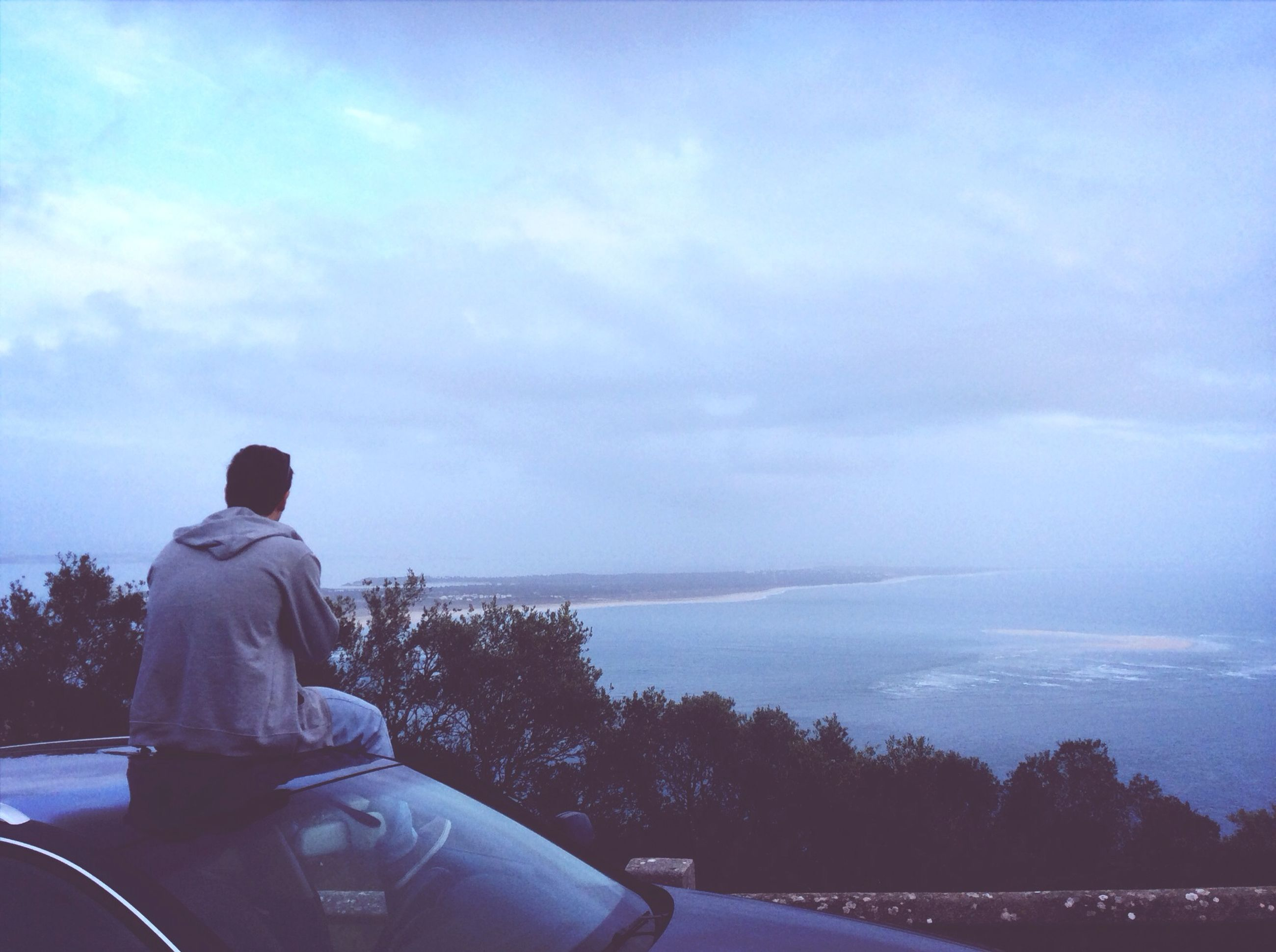 sky, rear view, lifestyles, water, cloud - sky, leisure activity, men, standing, sea, nature, looking at view, cloud, scenics, tranquility, sitting, beauty in nature, tranquil scene, relaxation