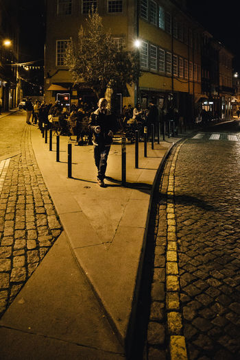 People on street in city at night