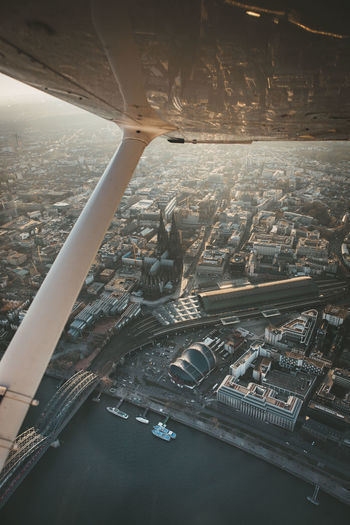 High angle view of cityscape seen through airplane window