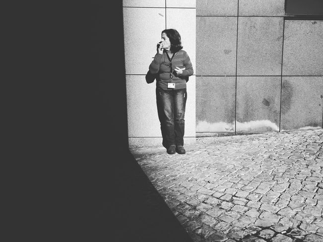 Smokers Outside The Hospital Doors Editors Real People Street Photography