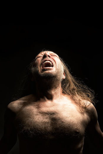 Adult Adults Only Beard Black Background Halloween Head Back Horror Human Body Part Looking Up Men Night One Man Only One Person Only Men People Religion Shirtless Sportsman Studio Shot