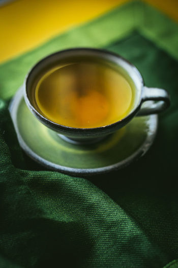 Close-up Day Drink Food And Drink Freshness Green Color Green Tea Healthy Eating Herbal Tea Indoors  Mint Tea No People Refreshment Saucer Table Tea - Hot Drink Tea Cup