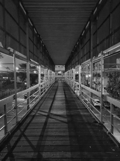 Empty footpath in illuminated building