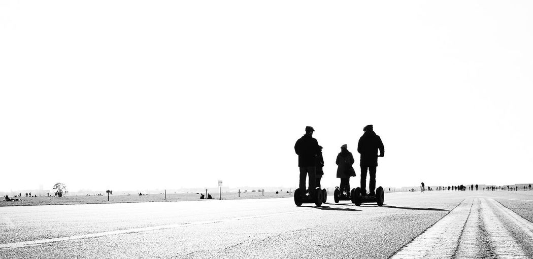 Berlin Photography City Life Tempelhof Tempelhofer Feld Tempelhofer Feld (Tempelhof Field) Tourist Traffic City Traffic E Mobility Electricity  Electro Mobility Electro Motion Empty Road Leisure Activity Long Way Mobility Mobility Scooter Real People Road Street Tempelhofer Freiheit Tourism Tourist Resort Transportation Urban Mobility Black And White Friday Mobility In Mega Cities #FREIHEITBERLIN