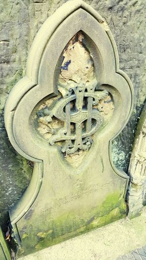 No People Outdoors Stonework Graveyard Gravestone Dollar Dollar Sign