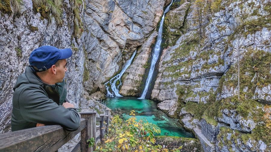 One Person Sitting Day Real People Lifestyles Outdoors Men Working One Man Only Adults Only People Adult Young Adult Only Men Travel Destinations Slovenia Water EyeEm Selects Waterfall Mountain Nature Beauty In Nature Green Color Adventure