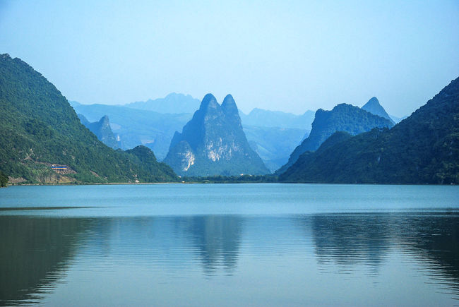 Tranquil lake and mountains scenery Guilin, Guangxi, China Hills Peace And Quiet Adventure Beauty In Nature Beauty In Nature Blue Sky Clear Sky Countryside Day Lake Mountain Nature Naturesque No People Outdoors River Scenery Scenics Sky Teflection Tranquil Scene Tranquility Travel Destinations Water