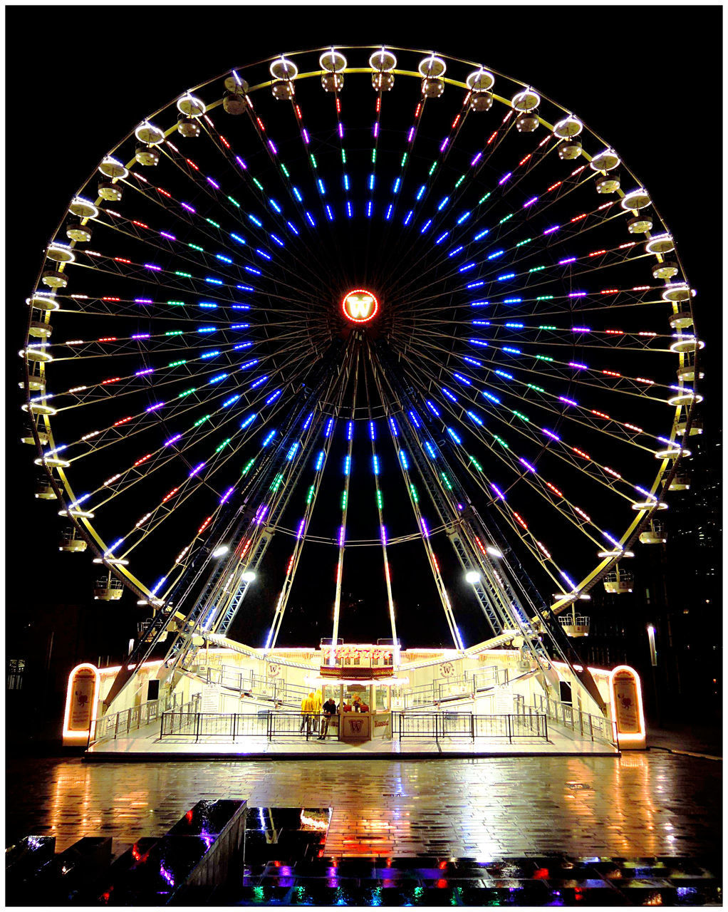 illuminated, architecture, amusement park, amusement park ride, arts culture and entertainment, night, built structure, ferris wheel, auto post production filter, building exterior, transfer print, water, city, multi colored, lighting equipment, outdoors, travel destinations, group of people, nature, light, nightlife, fairground