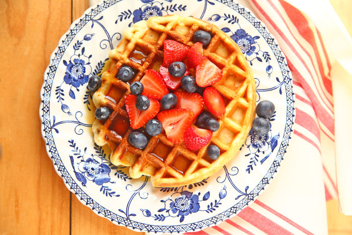 Waffle with fresh berries and syrup Breakfast Natural Light Red Textures Waffle Blue Blueberries Close-up Day Decorative Plate Dish Towel Food Fresh Fruit Indoors  Indulgence No People Overhead Ready-to-eat Serving Size Strawberries Sweet Food Syrup Treat White Wood Surface