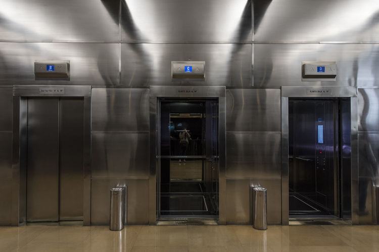 Indoors  Sign Transportation Subway Station No People Communication Entrance Absence Illuminated Architecture Technology Security Modern Door Safety Motion Convenience Silver Colored Steel Subway Train Elevator Edificio Comega Comega Buenos Aires Buenos Aires, Argentina