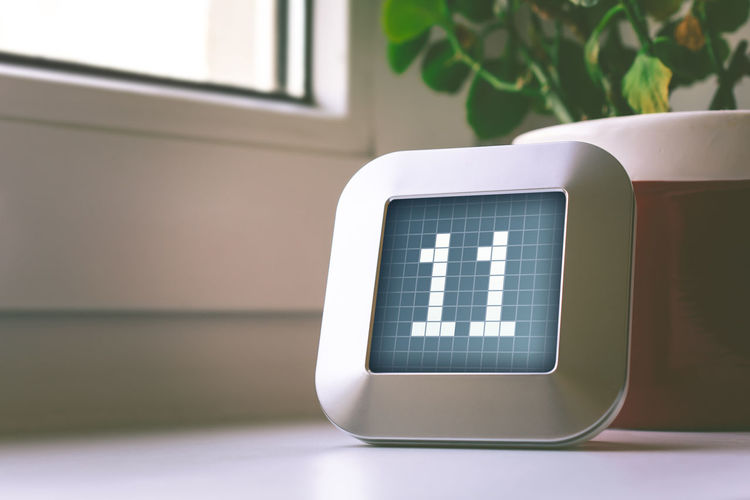 Close-up of number on digital display at table