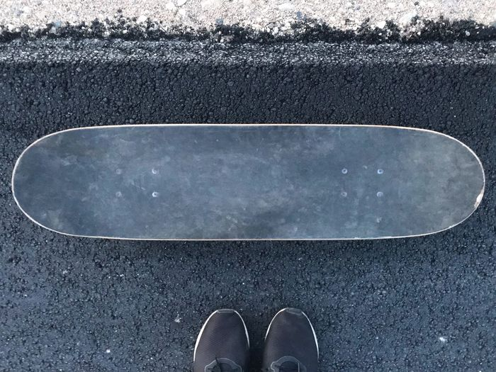 The Waiting Moment Skate Low Section One Person Standing High Angle View Lifestyles Day Unrecognizable Person Leisure Activity Road Human Foot Outdoors First Eyeem Photo EyeEmNewHere