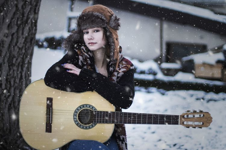 Portrait of a young woman in snow