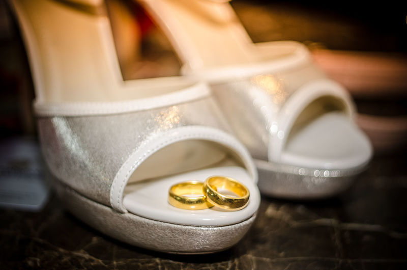 Close-up of wedding rings on high heels