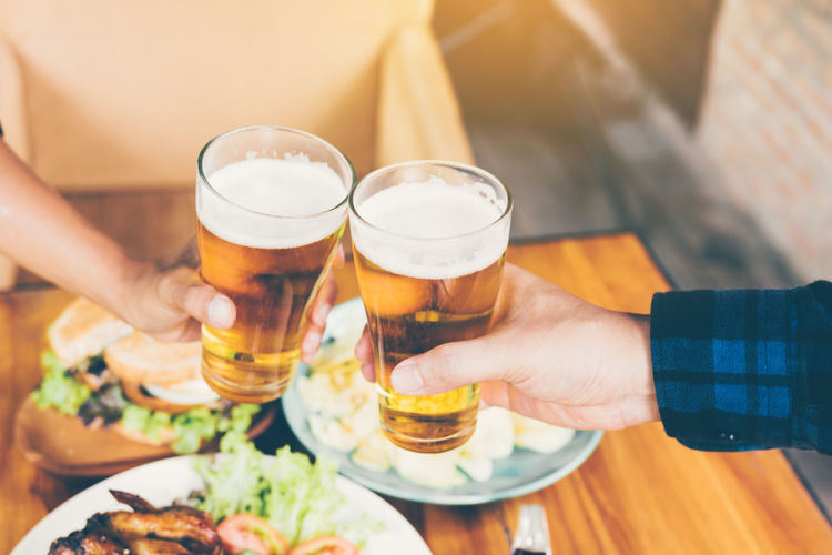 Adult Alcohol Beer Beer - Alcohol Beer Glass Celebratory Toast Drink Food Food And Drink Freshness Glass Hand Holding Human Body Part Human Hand Indoors  Lifestyles Men Real People Refreshment Table