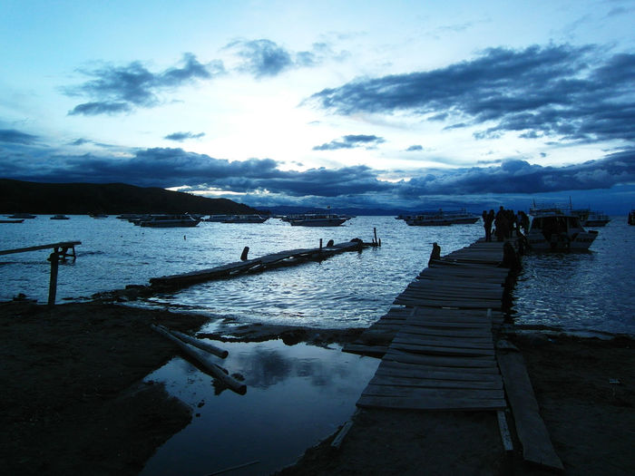 Titicaca Lake | Bolivia Beach Beauty In Nature Blue Bolivia Cloud - Sky Clouds Cold Day Footbridge Idyllic Isla Del Sol Lake Nature Nautical Vessel Outdoors Pier Scenics Sea Silhouette Sky Sunset Titicaca Tranquil Scene Tranquility Water
