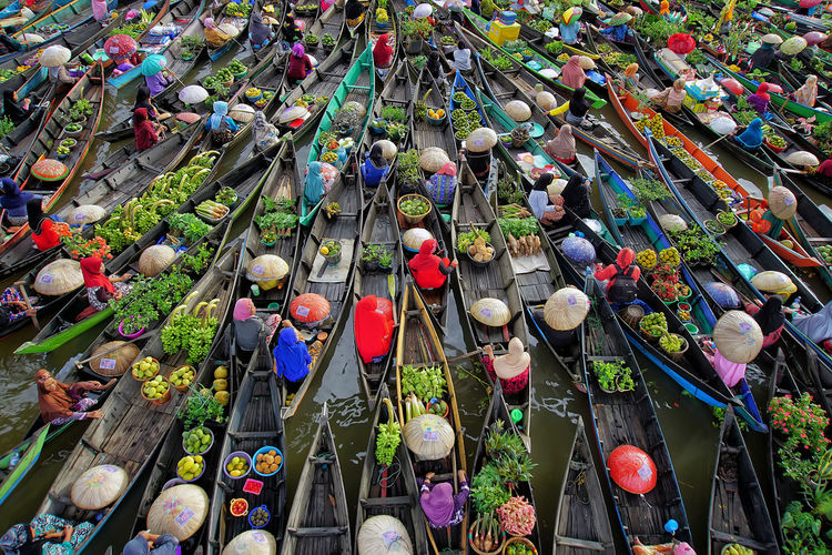 High Angle View Of People Selling Vegetables In Boats At Floating Market
