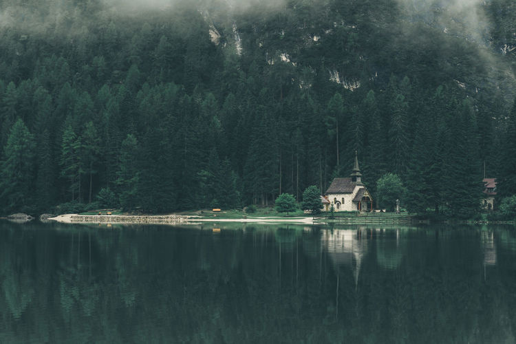 Beautiful and lonely little chapel at lake Braies in South Tyrol, Italy Believe Chapel Church Europe Faith Fog Green Italy Lago Di Braies Lake Medieval Mood Moody Weather Nature No People Outdoors Peace Peace And Quiet Peaceful Reflection Religion Serene South Tyrol Tranquil Scene Wallpaper