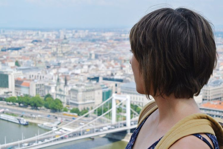 Close-up of woman looking at cityscape