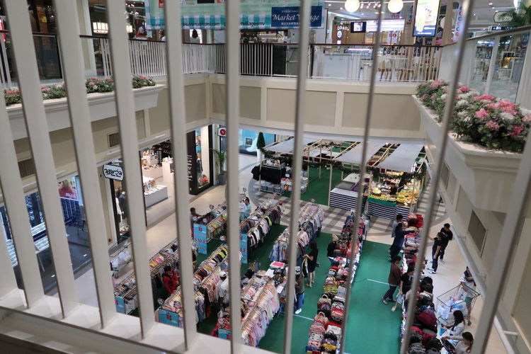 Indoors  Retail  Business Finance And Industry Store Day Trading Stell Grilled Space Between High Angle View Clothing Ground Floor Walking Around The City  Flower Green Color White People Commercial