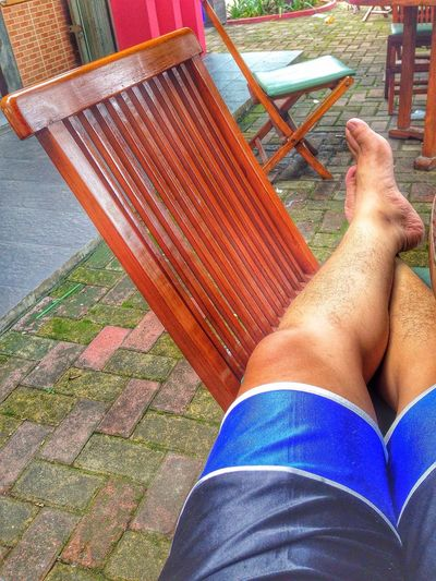 Sit and Waiting here. Foot and Wood