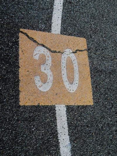 Number 30 Road Asphalt Textured  Street Close-up