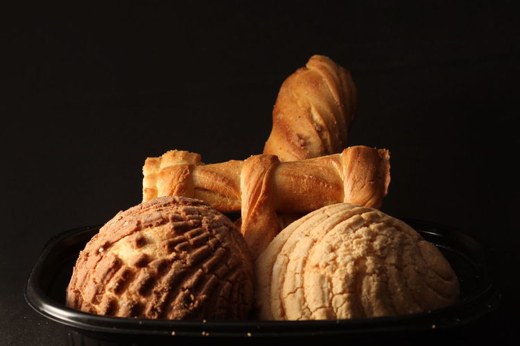 Close-up of bread against black background