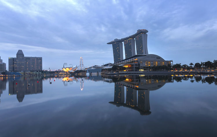 Marina Bay Sands Singapore Architecture ASIA Asian  Blue Building Exterior Built Structure City Cloud Cloud - Sky Cloudy Illuminated Marina Bay Sands Modern Nature Outdoors Reflection Shopping Mall Singapore Sky Tall - High Tourism Travel Destinations Water Waterfront