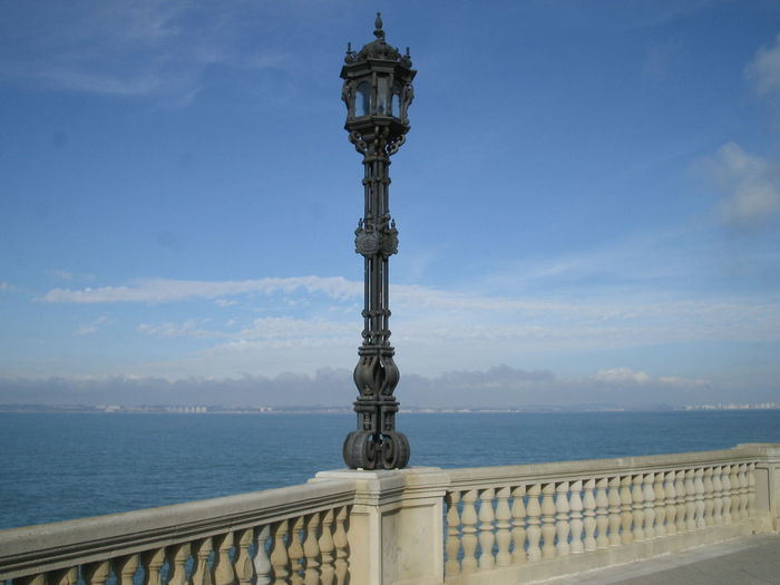 Lamp Post On Balustrade At Promenade Against Blue Sky