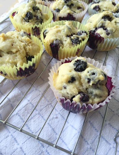 Blueberry muffins on rack Baked Goods Baking Blueberry Muffins Breakfast Close Up Cooling Rack Dish Towel Fabric Food Fruit Ingredient Home Cooking Homemade Food Indulgence Natural Light No People Snack Tasty Textures Treat
