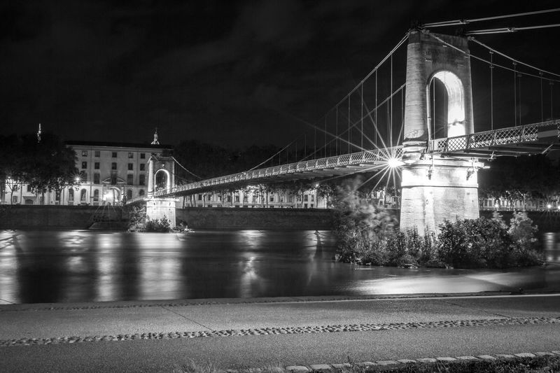 City of Lyon France by nigh Lyon France Rhône-Alpes Arch Architecture Bridge - Man Made Structure Built Structure Chain Bridge City Connection Engineering Europe Illuminated Long Exposure Monochrome Photography Night No People Outdoors River Sky Suspension Bridge Transportation Travel Travel Destinations Water