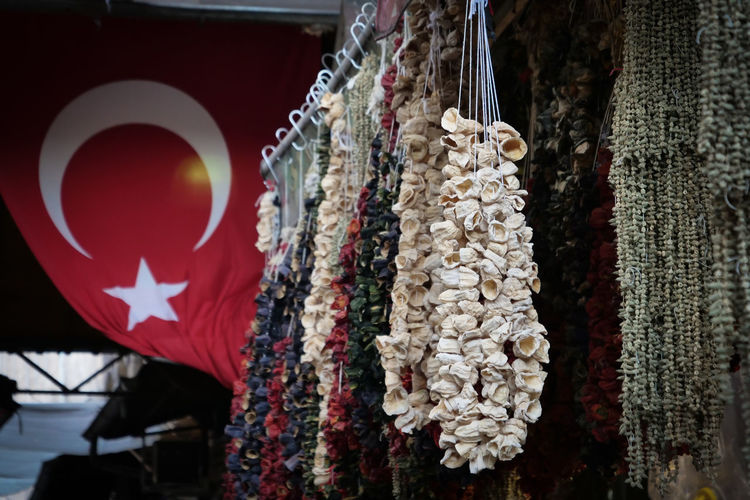Hanging Red No People Focus On Foreground Decoration Retail  Market Close-up For Sale Market Stall Shape Flag Outdoors Built Structure Day Low Angle View Choice Variation Retail Display Turkish Flag Turkey Dried The Traveler - 2019 EyeEm Awards The Street Photographer - 2019 EyeEm Awards The Foodie - 2019 EyeEm Awards