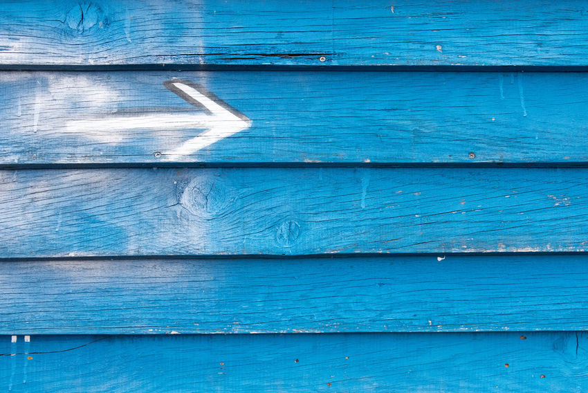 Wood - Material Blue Full Frame Backgrounds No People Day Pattern Textured  Outdoors Close-up Plank Old Paint Wall - Building Feature Weathered Security Metal Door Wood Protection Corrugated Arrow Arrow Symbol Arrow Sign Wooden Painted Rusty Knotted Wood Hardwood Scratched