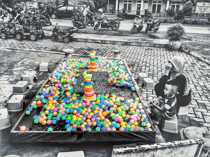 The Street Photographer - 2017 EyeEm Awards Multi Colored Game Playground Blackandwhite IPhoneography Indulgence Sprinkles Temptation Day Outdoors Mother And Son