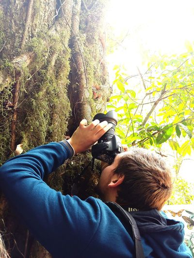 taking photos Blue Moss Moss Covered Tree Forest Photography EyeEm Nature Lover EyeEm Best Shots Photographing Photographer Peaceful Nature Trees And Sky Outdoor Photography Photography Human Hand Low Section Technology Men Holding Close-up Personal Perspective Leisure Recreation  Photographing Camera Camera - Photographic Equipment