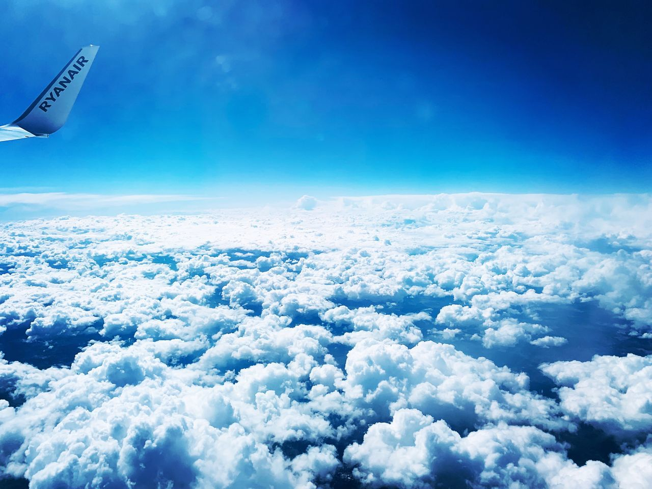 cloud - sky, sky, scenics - nature, blue, beauty in nature, nature, mid-air, flying, cloudscape, no people, air vehicle, airplane, day, tranquility, tranquil scene, aerial view, mode of transportation, idyllic, outdoors, transportation, above, softness, meteorology
