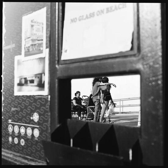 Coney Island Couple / May 2018 / Hasselblad 500c / Kodak Tri-X 400 film. EyeEm Diversity eyeemphoto EyeEm Best Shots - Black + White EyeEm Masterclass EyeEmBestPics EyeEm Selects EyeEm Gallery EyeEm Best Shots EyeEm Bnw EyeEmNewHere People Blackandwhite Street Medium Format New York Streetphoto_bw Street Photography Streetphotography 120 Film Film Photography Bnw_friday_eyeemchallenge Bnw_captures Bnw_collection Bnw Kodak Tri-X 400 Kodak Hasselblad500c Hasselblad