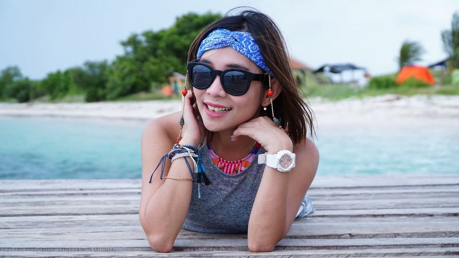 Sunglasses Young Adult One Person Young Women Outdoors Leisure Activity Focus On Foreground Real People Water Day Lifestyles Beach Sea Nature Vacations Beautiful Woman Portrait Happiness Sky People