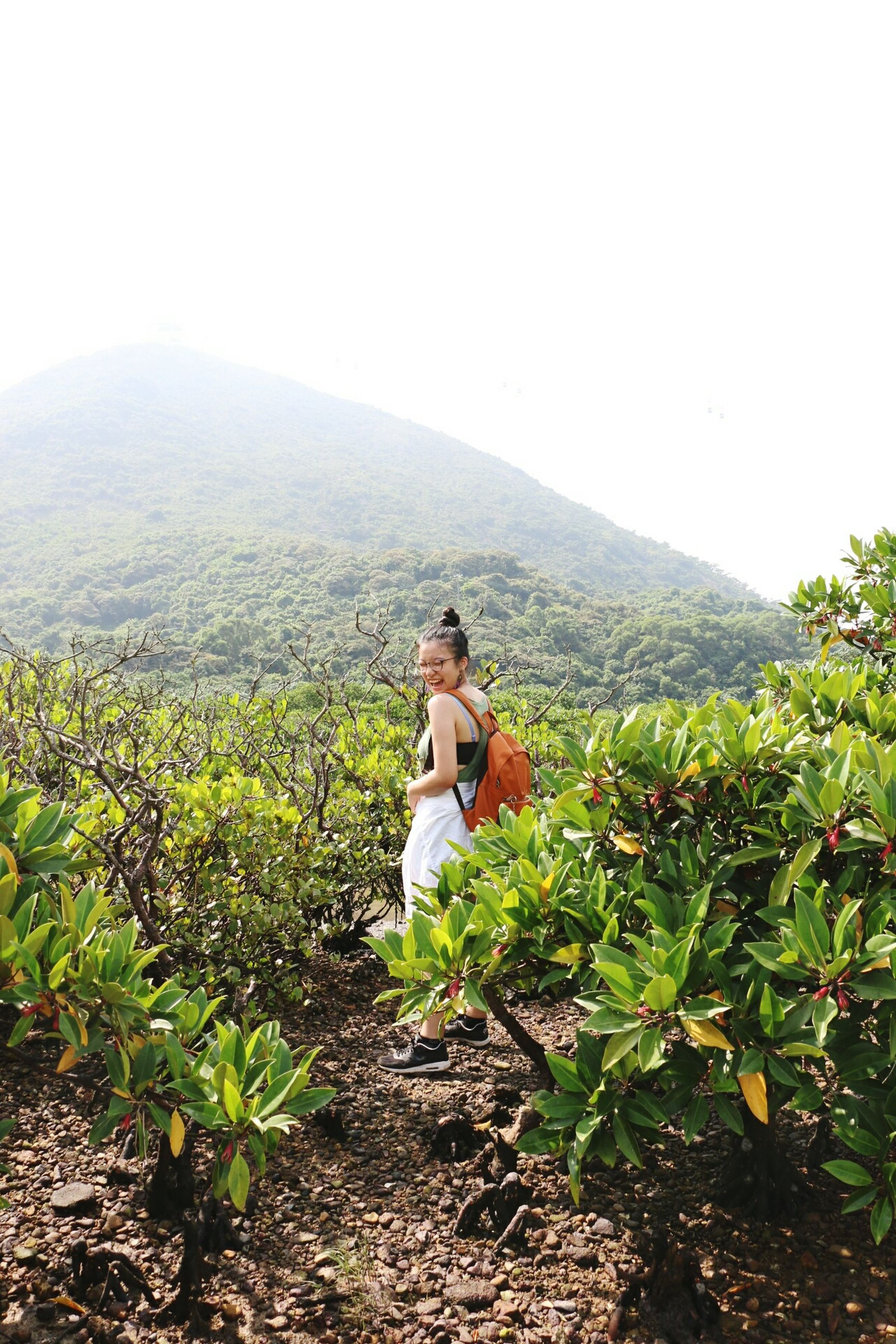 leisure activity, lifestyles, mountain, rear view, men, plant, standing, flower, person, water, beauty in nature, tranquil scene, tranquility, growth, scenics, mountain range, casual clothing, relaxation, vacations, nature, day, weekend activities, non-urban scene, carefree, getting away from it all, sea, solitude, outdoors