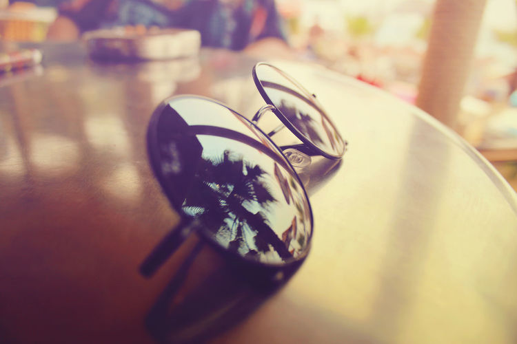 Canon600D Nice View Palm Tree Palms Turkey Vacations Canon Canon_photos Canonphotography Close-up Day Indoors  Luxury No People Outdoor Photography Outdoors Rayban Sea Life Selective Focus Silver  Still Life Sunglass  Sunglasses Table Vacation
