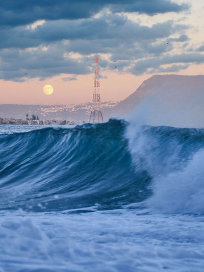 Waves on Messina Cloud - Sky Sky Sunset Scenics - Nature Water Beauty In Nature Nature Sea Motion No People Waterfront Outdoors Built Structure Tower Architecture Power In Nature Travel Destinations Tourism Moon Messina Sicily Italy Mediterranean Sea Pylon Pylons And Power Lines