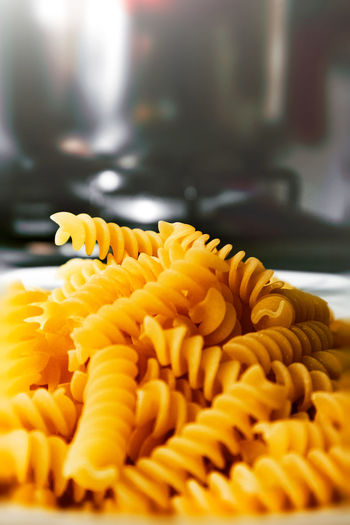 Close-up of yellow pasta on table Cooking Dinner Food Lunch Macaroni Nature Pasta Blur Carbohydrate Delicious Health Ingredients No Person Noodles Nutrition Penne Spaghetti Still Life Traditional Wheat Close-up Freshness Selective Focus Indoors  No People Yellow Food And Drink Italian Food Flower Focus On Foreground Beauty In Nature Raw Food Day Flowering Plant Preparation  Large Group Of Objects