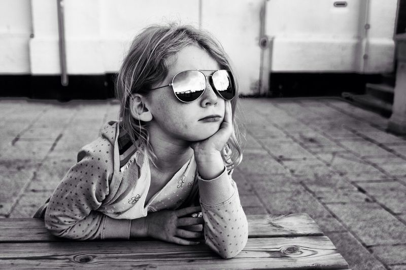 Girl with sunglasses looking away