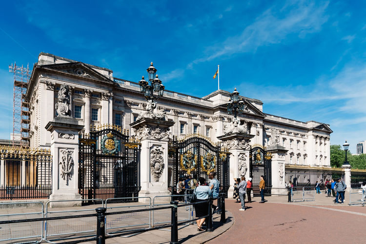 Buckingham Palace a sunny day at springtime Brexit Britain Buckingham Buckingham Palace London Queen Uk Architecture Blue British Building Capital City Culture Destinations Elizabeth England English Europe European  Famous Great Guard Historic History KINGDOM Landmark Monarchy Monument Old Palace People Place Royal Royalty Sightseeing Sky Statue Sunny Tourism Tourist Tradition Traditional Travel United Weather Westminster Building Exterior