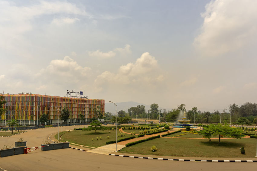KIGALI,RWANDA - OCTOBER 19,2017: KG 2 Roundabout area This road is free of traffic. There is the Radisson Blu Hotel,a big,modern and expensive hotel near the Convention Centre. Kigali Rwanda Africa Architecture Building Exterior Built Structure Cloud - Sky Day Golf Course Grass Nature No People Outdoors Playing Field Sky Soccer Field Sport Stadium Tree
