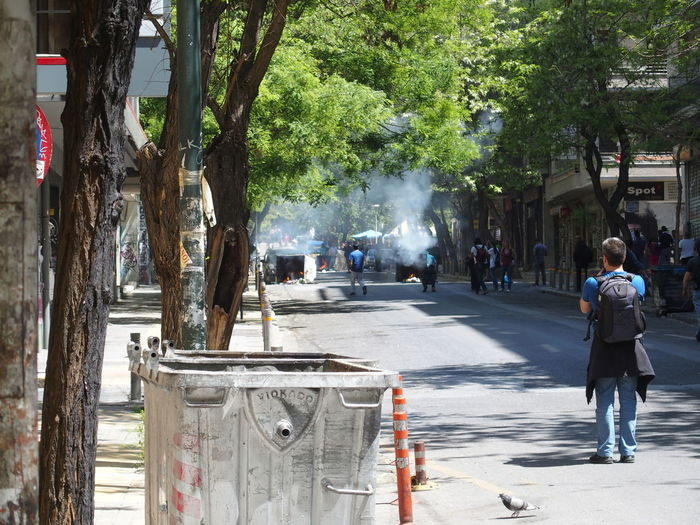 Demonstration in Athens, may 2015 Athens City City Life Demonstration Lifestyles May 2015 Outdoors Protest Rear View Reporter Smoke Street