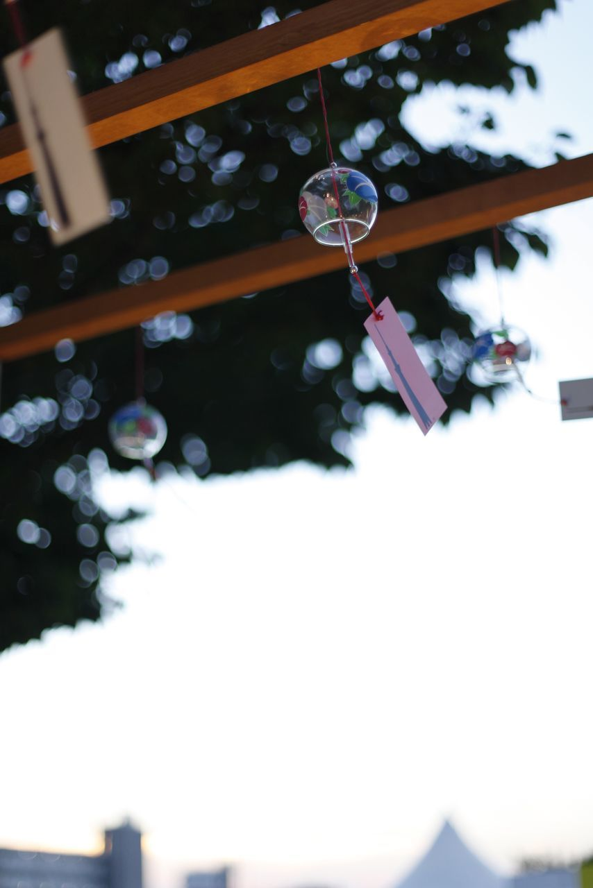 LOW ANGLE VIEW OF DECORATIONS HANGING FROM ROOF