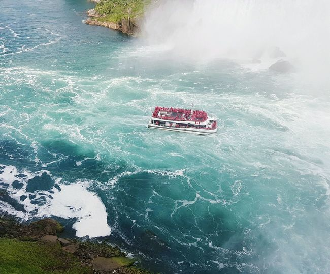 High angle view of red boat in sea against sky